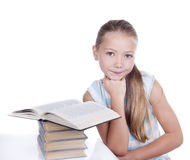 Little girl. Portrait of a young girl with books Royalty Free Stock Image