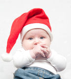 Little girl. In red cap Royalty Free Stock Photos