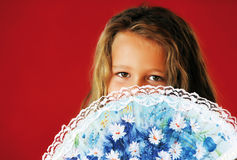 Little girl. With air fan in front of the face Stock Images