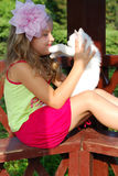 The little girl. With a white kitten on a bench Royalty Free Stock Photography
