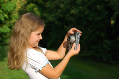 The little girl. With the old camera in a white dress Stock Images