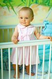 Little girl. Portrait of little girl in crib royalty free stock photos