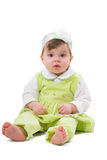 Little girl. Girl at the age of 1 year sitting on white background Royalty Free Stock Photos