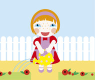 Little girl. Girl pouring on flowers near garden Royalty Free Stock Photo