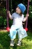 Little girl. On the swing stock photo