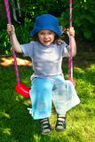 Little girl. On the swing Royalty Free Stock Photo
