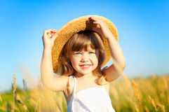 Little girl. Beautiful little girl on the meadow in summer day royalty free stock photo