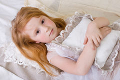 Little girl. Portrait of lying in bed a little girl Royalty Free Stock Photography