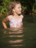 Little girl. During summer in nature pool stock photos