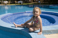 Little girl. Sitting near swimming pool Royalty Free Stock Image