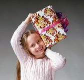 Little girl. Portrait of happy little girl with gift box Stock Photography