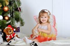 Little girl. At a Christmas fir-tree stock photos