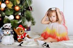 Little girl. At a Christmas fir-tree royalty free stock photos