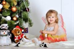 Little girl. At a Christmas fir-tree stock photography