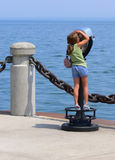 Little girl. An little girl on an telescope looking over the lake Ontario on the lake Stock Image