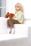 Little Girl 3 years with a brown teddy bear Royalty Free Stock Photography
