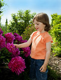 Little girl 3 years old in the garden Stock Image