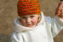 Little girl. In winter clothes take granny's hand Royalty Free Stock Photography