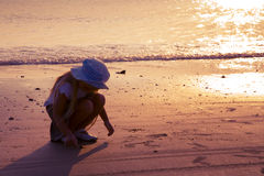 Little girl. On the seashore in sunset Stock Image