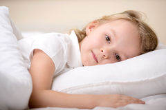 Little Girl. Adorable little girl awaked up in her bed Stock Photos