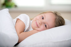 Little Girl. Adorable little girl awaked up in her bed Stock Photography
