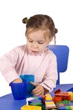 Little girl. Sitting on the chair and  playing Royalty Free Stock Photography
