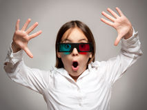 Little girl with 3d glasses a watching movie Stock Image