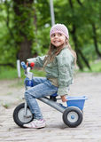 Little girl ( 4-5) on tricycle Stock Images