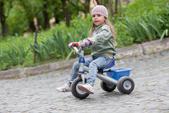 Little girl ( 4-5) on tricycle Stock Photography