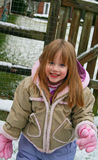 Little girl. Having fun in the snow Stock Photo