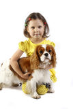 little girl 5 years old and the dog isolated Stock Photo