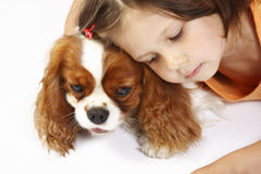 little girl 5 years old and the dog isolated Royalty Free Stock Photography