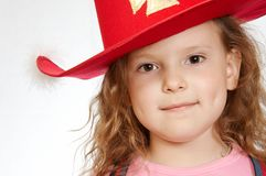 Little girl. The little girl in a red hat royalty free stock photo
