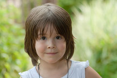 Little girl. With brown eyes and hairs, close-up Royalty Free Stock Photography