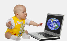 Little girl. Touching screen on the laptop Stock Photography
