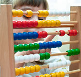 Little Girl with abacus. Little Girl contemplates the basics of arithmetic on his abacus Stock Photography