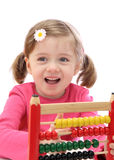 Little girl with abacus Royalty Free Stock Photo