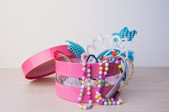 Little girl accessories lifestyle set in a pink box. Royalty Free Stock Photography
