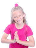 Little girl acting. A cute little happy smiling Caucasian girl child with folded hands acting like Indian dancer. Image isolated on white studio background royalty free stock photography