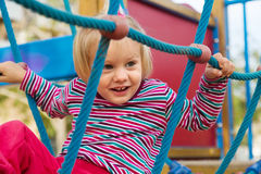 Little girl at action-oriented playground Royalty Free Stock Images