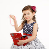Little girl admires the accessories in the box Royalty Free Stock Photography