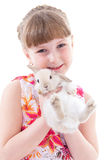 Little girl with adorable rabbit stock image