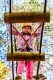 Little girl in the Adventure Park. Little girl is climbing in the Adventure Park royalty free stock photography