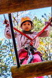 Little girl in the Adventure Park. Little girl is climbing in the adventure park royalty free stock photo