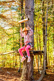 Little girl in Adventure Park. Little girl is hanging on a swing in adventure park royalty free stock photography
