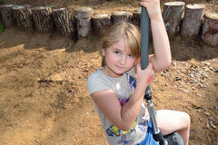 Little girl in an adventure park Stock Photos