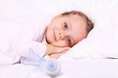 Little girl after aerosol treatment Stock Images
