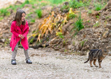 Little girl afraid of a cat Royalty Free Stock Images