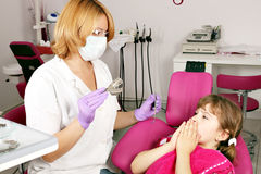 Little girl is afraid of the dentist Stock Photography