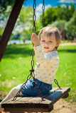 Little girl afraid of swinging Royalty Free Stock Photos